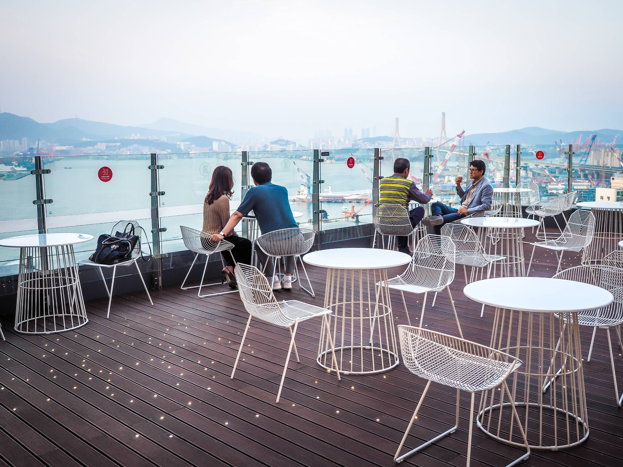 Outdoor patio of Maxim's de Paris cafe with view of Busan Harbor